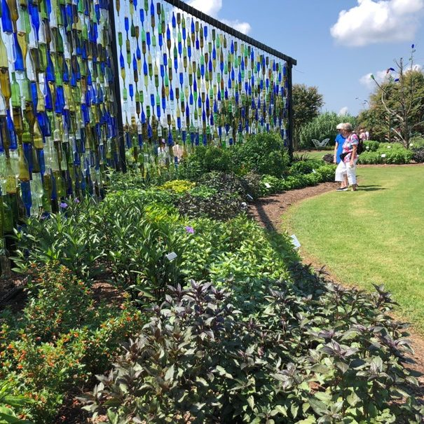 Wall of colored bottles in the Gardens area